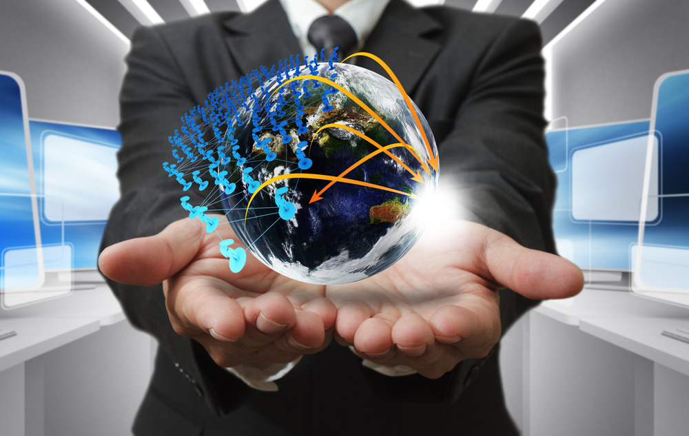 "Business Man Hand Holds Globe And Social Network""Elements Of This Image Furnished By NASA"""